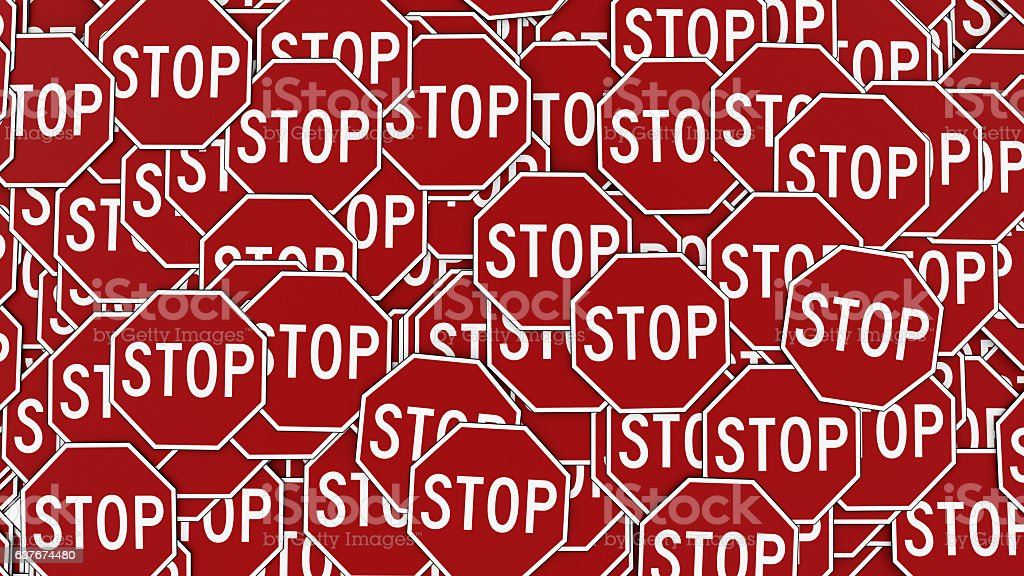 Wall of Octagonal Red Stop Signs stock photo