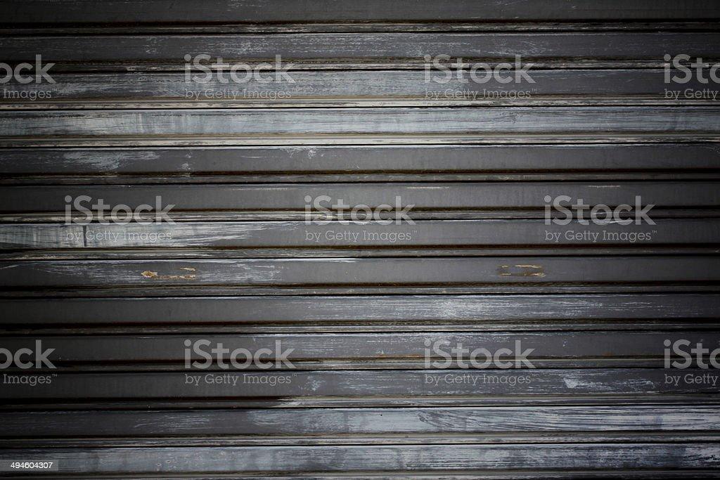 Wall of old color steel rolling door. stock photo
