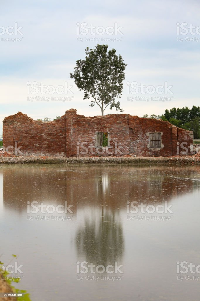 Wall of ruined brick building stock photo