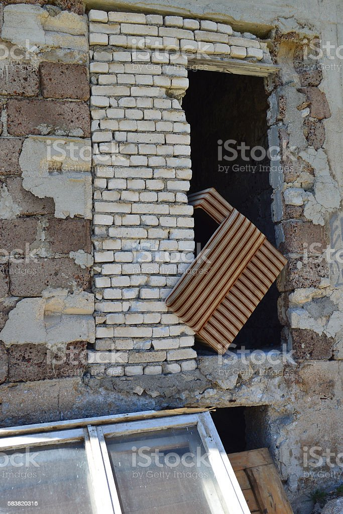 Wall of ruined industrial building stock photo