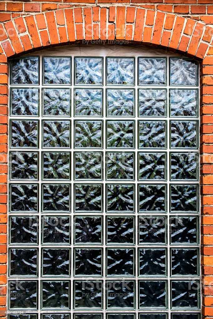 wall of small bricks with a window stock photo
