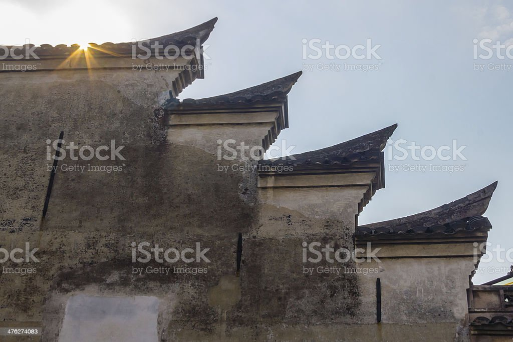 wall of southern chinese buildings with sunlight stock photo