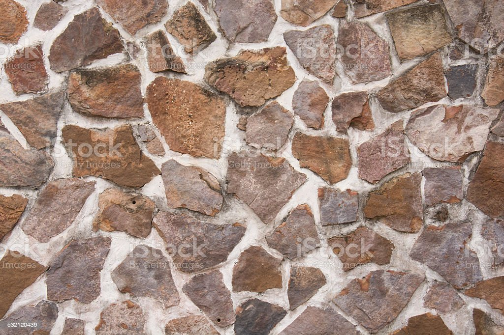Wall of stacked stone stock photo