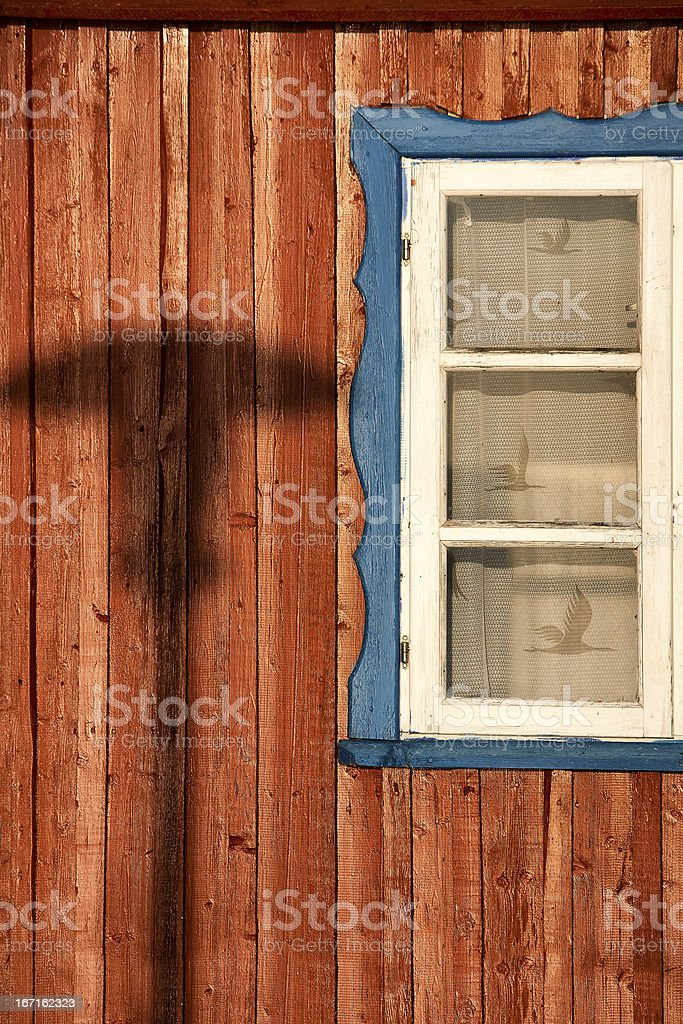 Wall of the house with a window royalty-free stock photo