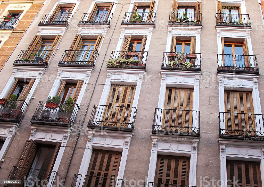 wall of the house with balconies and shutters stock photo