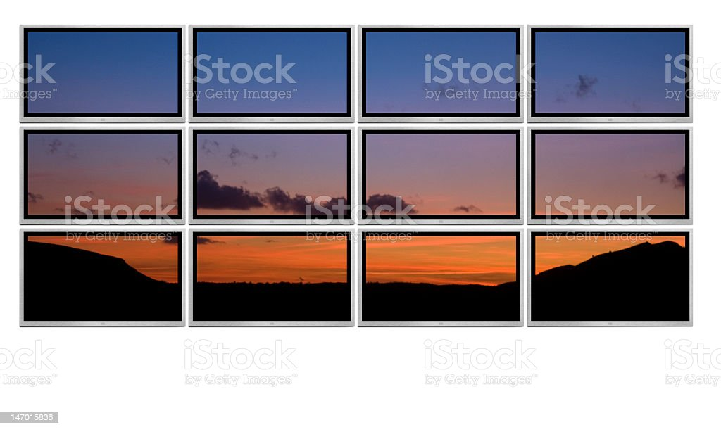 Wall of twelve TV screens showing a single image stock photo