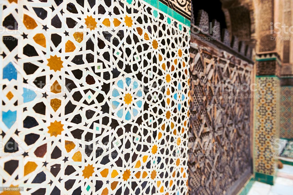 Wall ornamented with tiles in the Madrasa Bou Inania, in Fez stock photo
