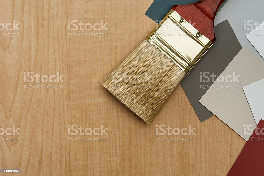 Wall paint brush with color chip samples stock photo