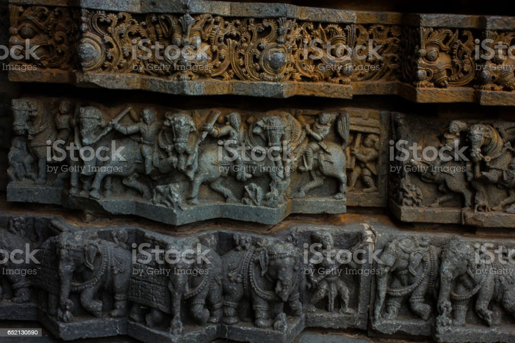 Wall panel relief and molding frieze in horizontal treatment in Chennakesava Temple, Somanathapura, Karnataka,Asia, India stock photo