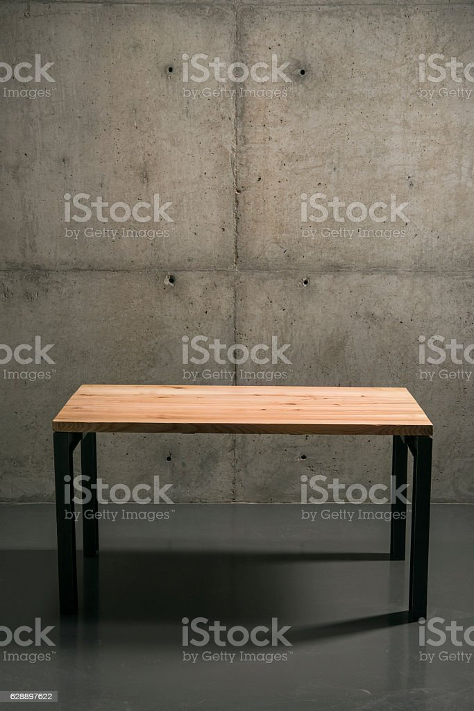 wall panels with concrete, style loft, minimalism. wooden table stock photo