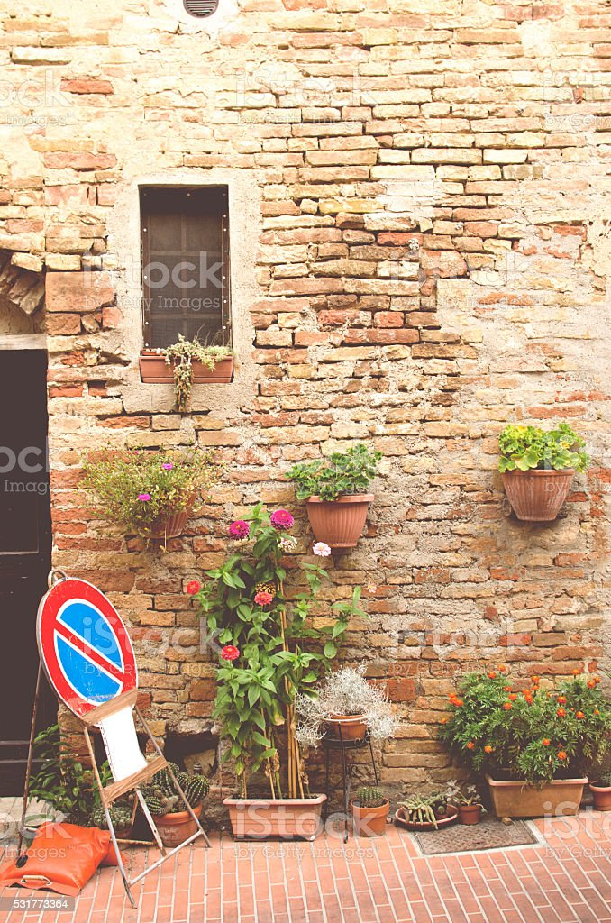 Wall, plants and traffic sign in Tuscany, Italy, Europe stock photo