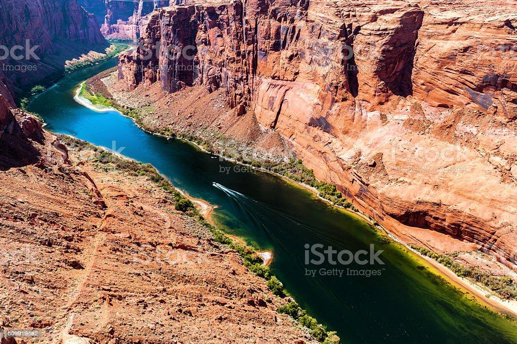 Wall, reflections, canyon, boat on Colorado River, Arizona, USA stock photo