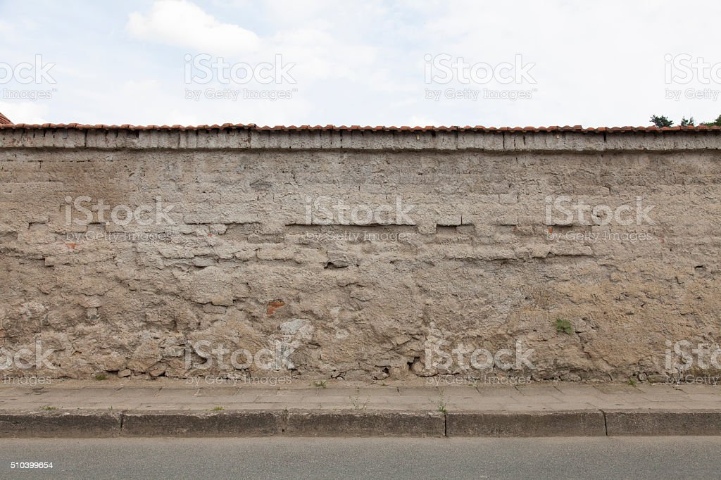 wall sidewalk curb street stock photo