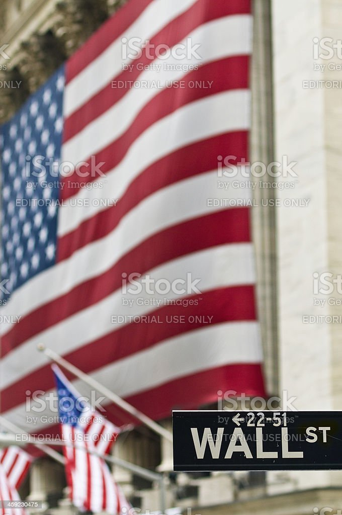 Wall St sign New York Stock Exchange Stars and Stripes stock photo