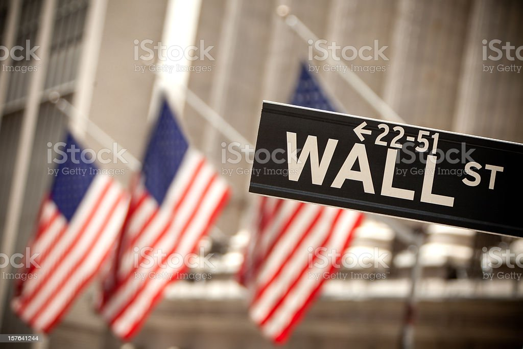 Wall Street and american flag stock photo