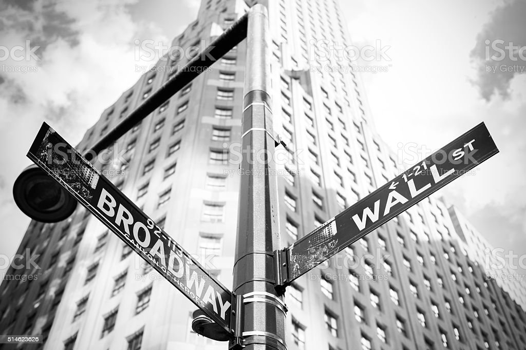 Wall Street and Broadway sign in Manhattan, New York. stock photo