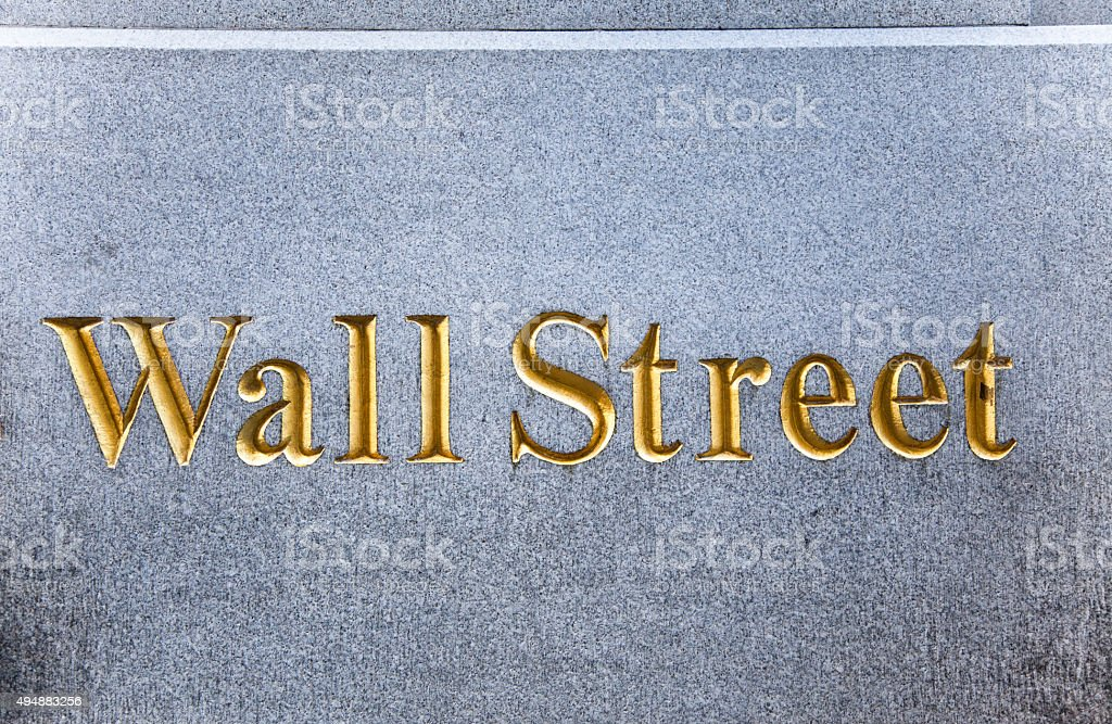 Wall Street etched on financial building. New York City. stock photo