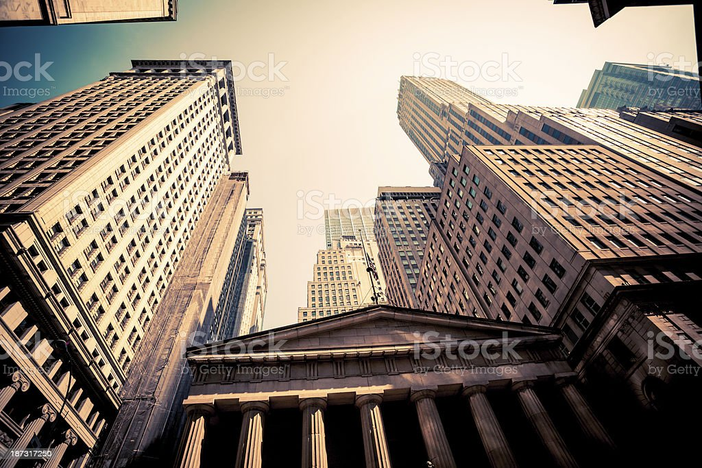 Wall Street in Downtown Manhattan with Federal Hall and Skyscrapers stock photo