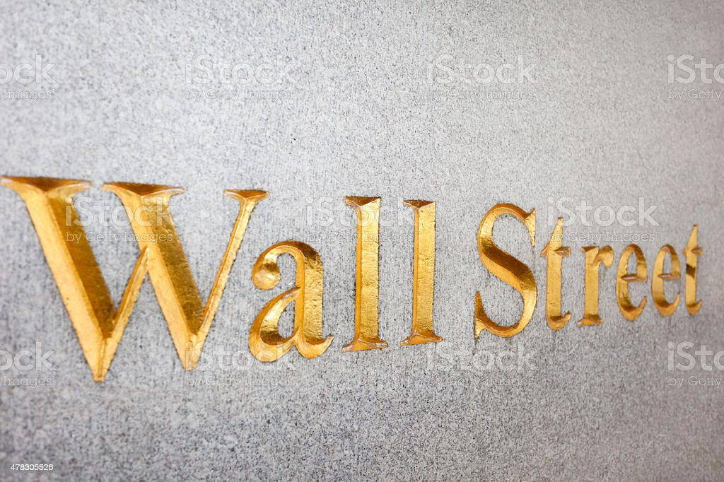 Wall Street Sign, Gold Inscription On Wall, Manhattan, New York stock photo