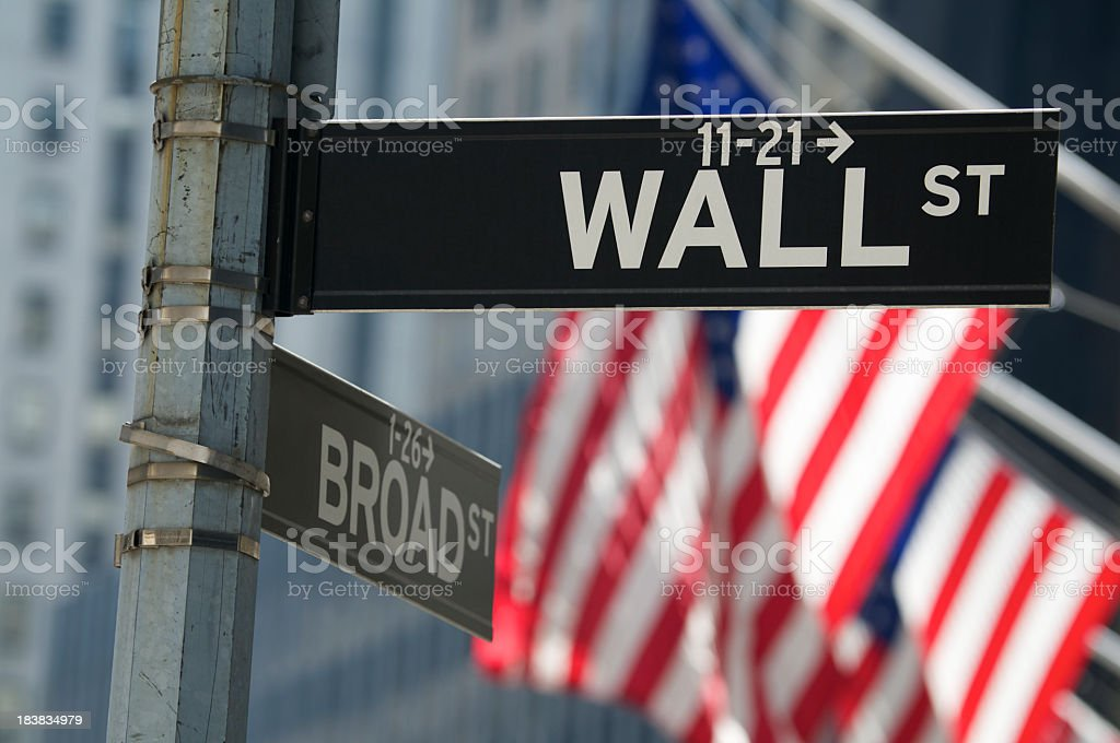 Wall Street Sign with American Flags stock photo