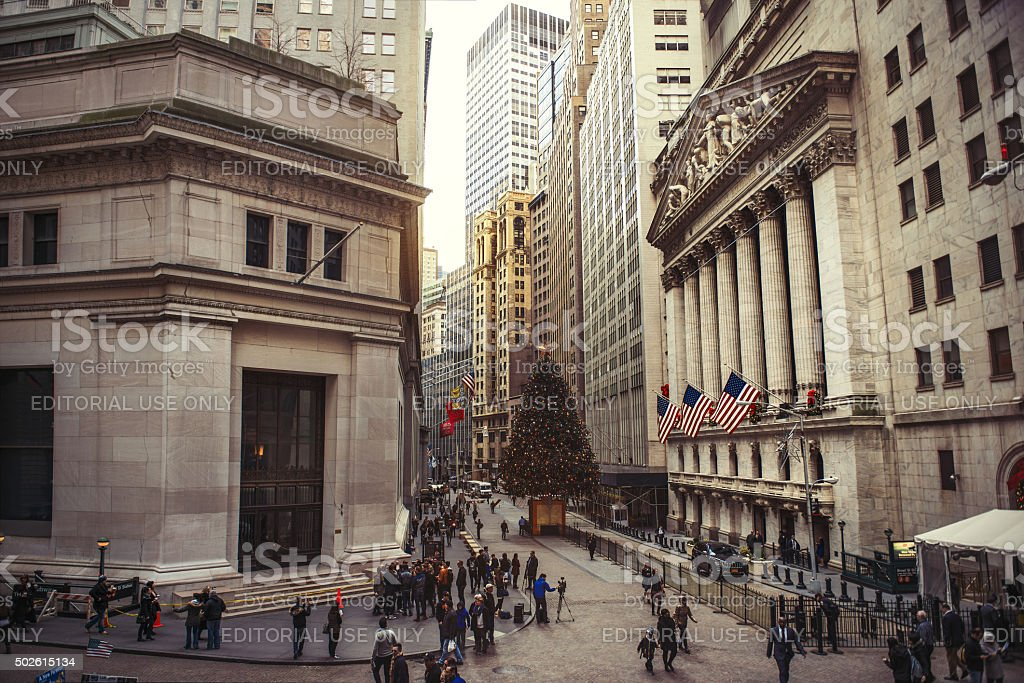 Wall Street with New York Stock Exchange in Manhattan stock photo