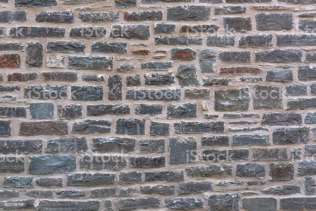 Wall structure of an old stone wall stock photo