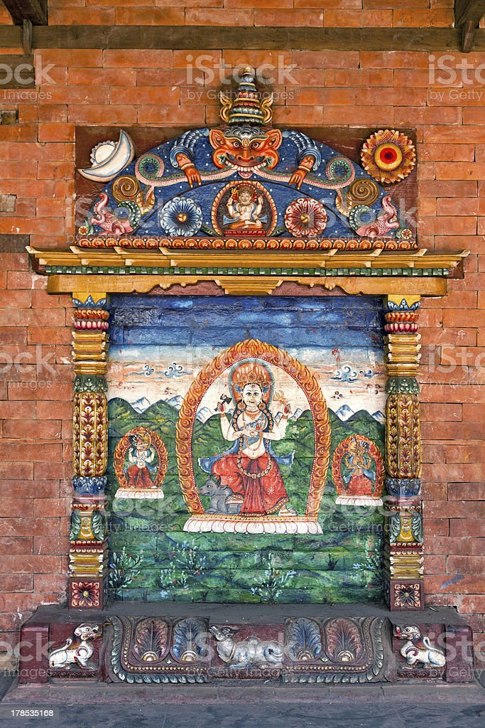 Wall temple of Durga, Hindu goddess with multiple arms royalty-free stock photo