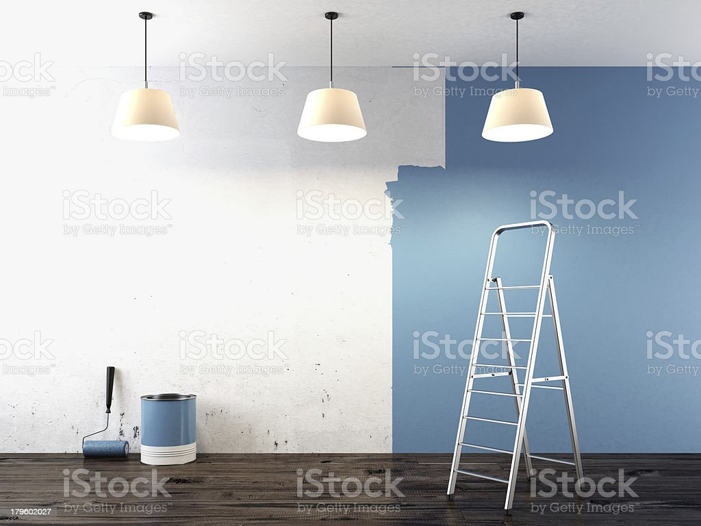 A wall that is half-painted blue  stock photo