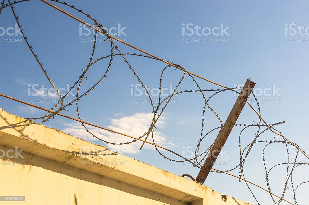 Wall With Barbed Wire stock photo 610120022 | iStock
