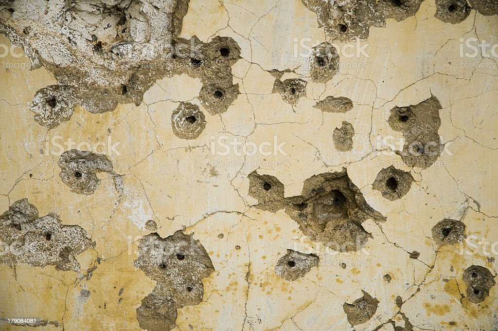 wall with bullet holes stock photo