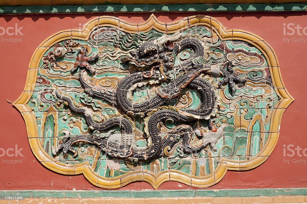 wall with carved murals of dragon stock photo