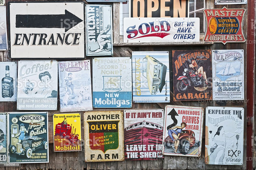 Wall with classic vintage store signs and posters stock photo
