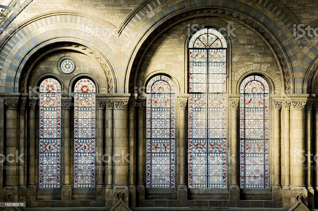 Wall with columns and stained windows. royalty-free stock photo