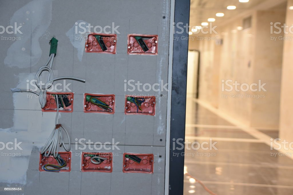 Wall with electrical points in the office under construction stock photo