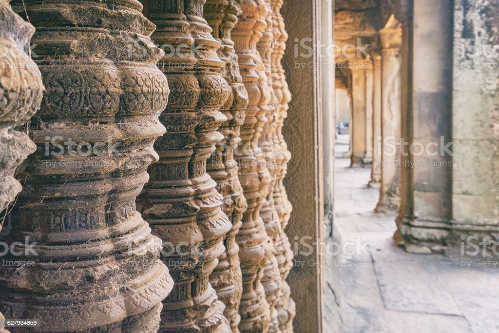 Wall with frescoes and columns of Angkor Wat, Cambodia. stock photo
