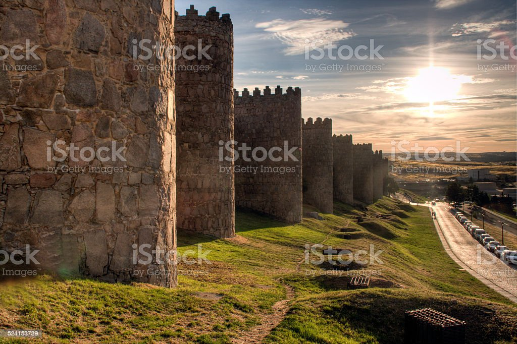 Wall with grass and sunset background stock photo