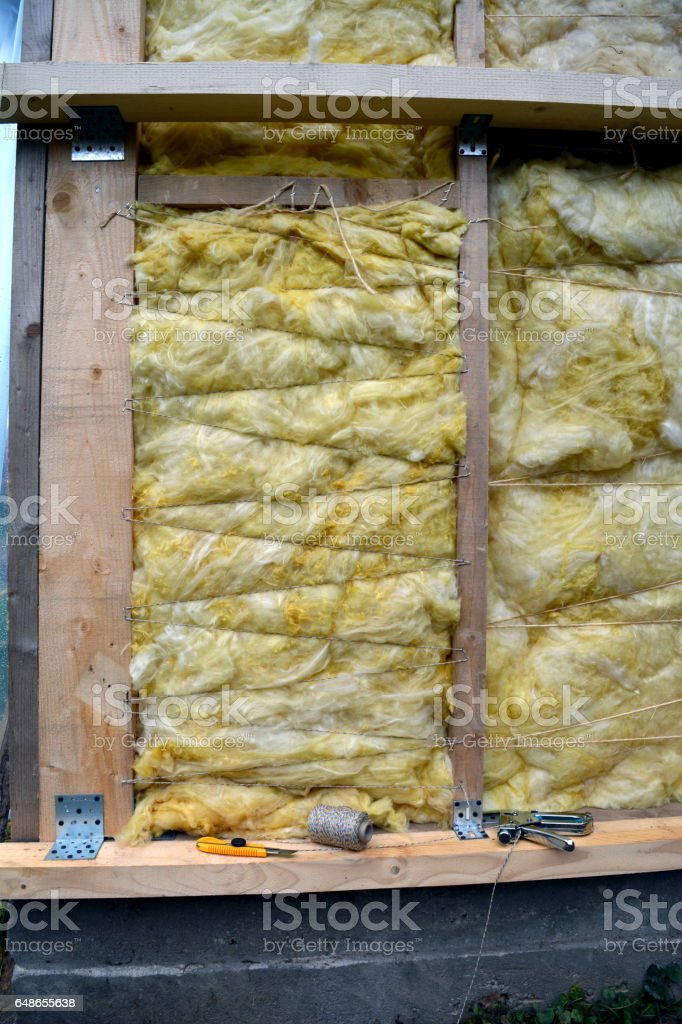 wall with insulation material rockwool and tools stock photo