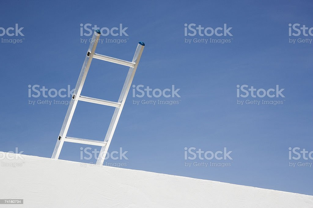 Wall with ladder and blue sky royalty-free stock photo