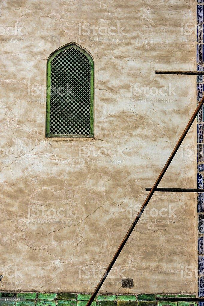Wall with oriental window stock photo