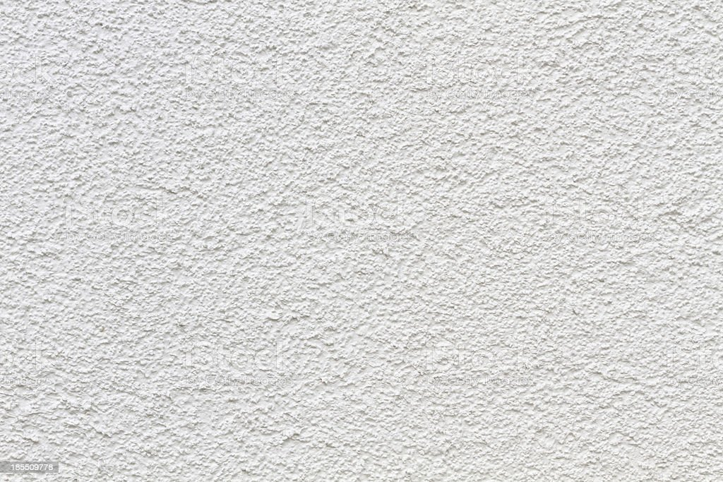 Wall with raw structure in white detail royalty-free stock photo