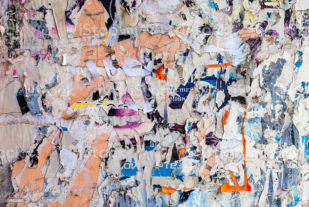 Wall with scraps of old paper as background stock photo