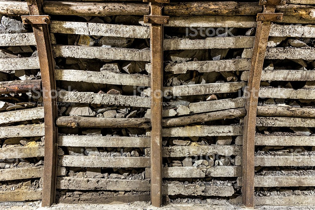 Wall with  steel support in the coal mine stock photo