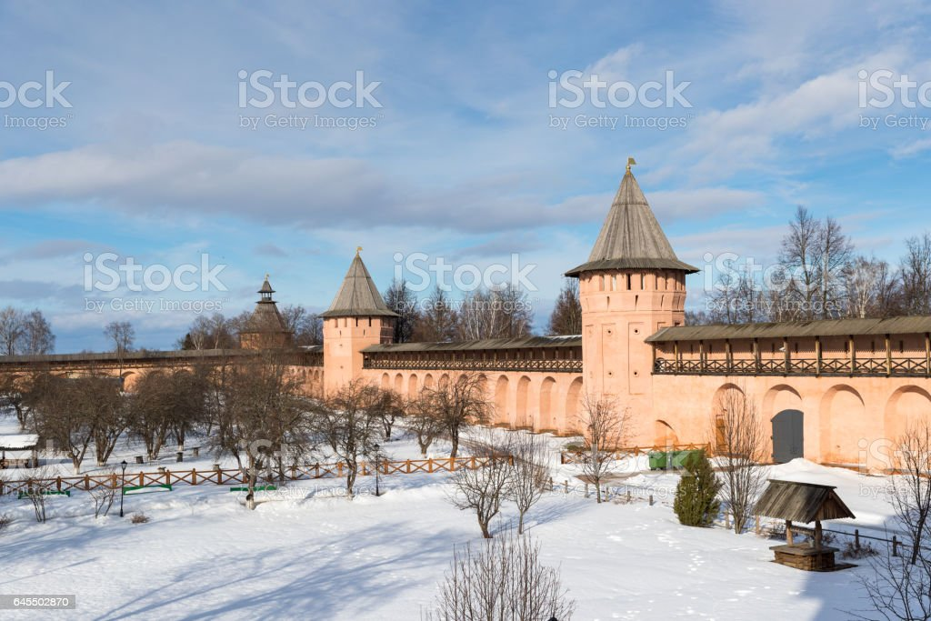 wall with towers in a medieval monastery stock photo