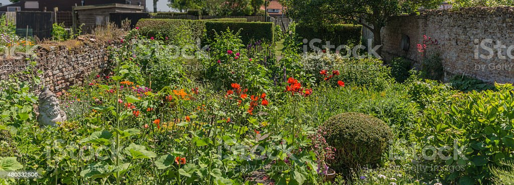 Walled Garden with antique gnome stock photo