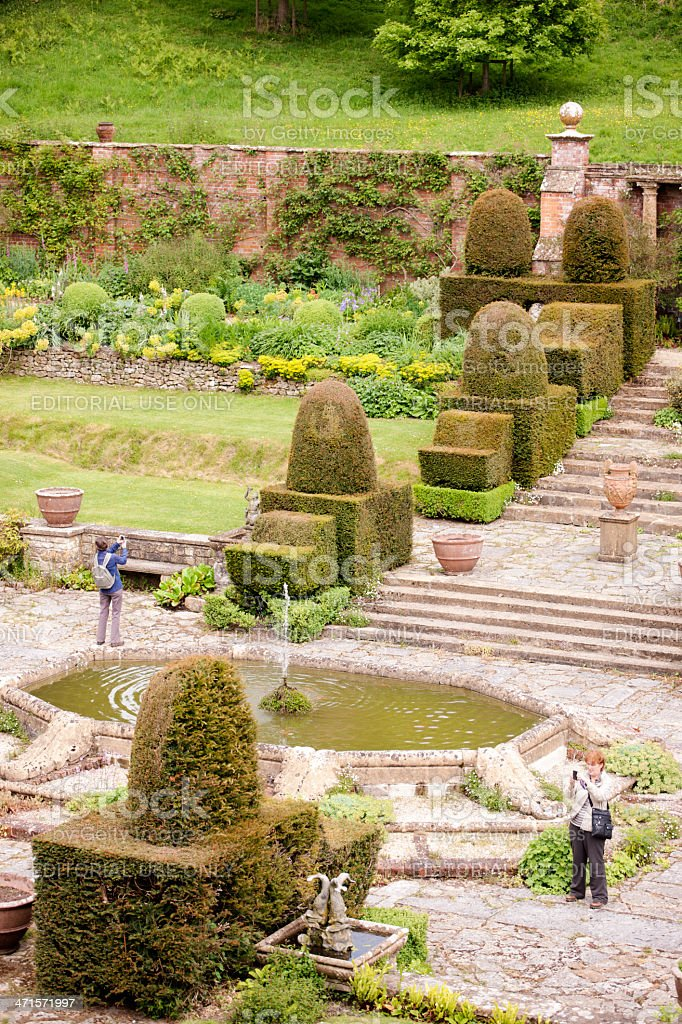 Walled garden with pond and topiary stock photo
