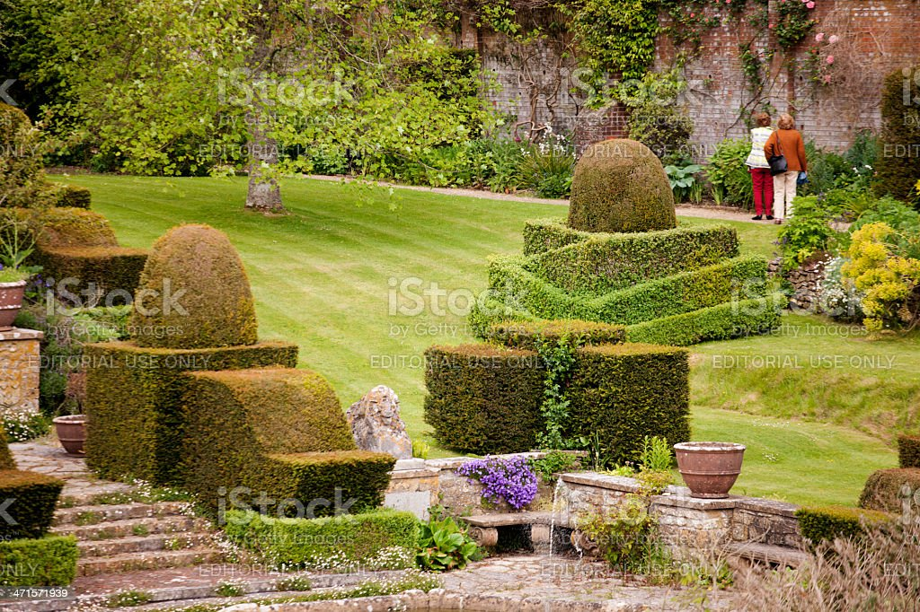Walled garden with topiary stock photo