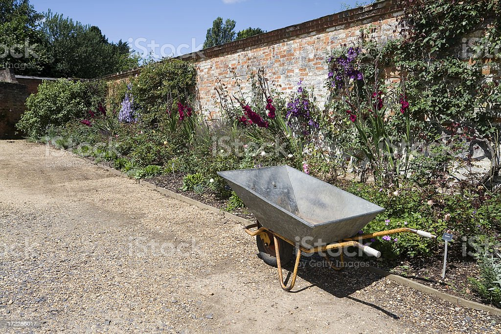 Walled Garden with Wheelbarrow stock photo