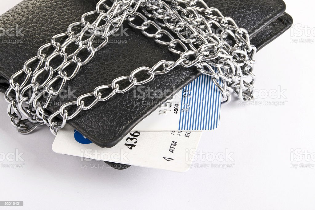 wallet and credit card tied with chain royalty-free stock photo