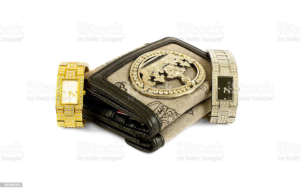 Wallet  and women's watches royalty-free stock photo