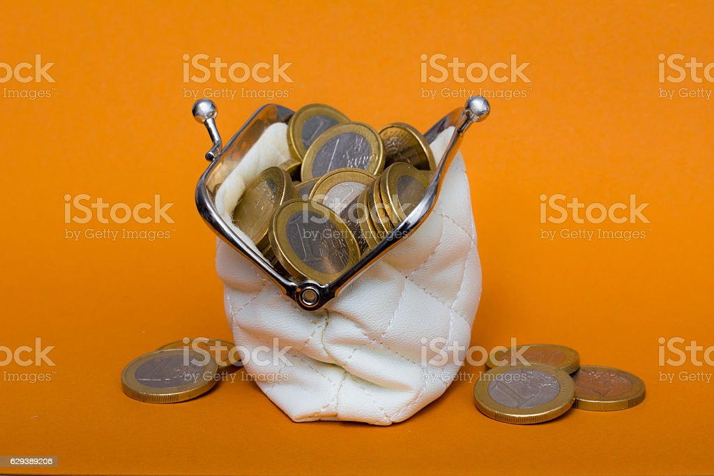 wallet filled to the rim  with one euro coins stock photo
